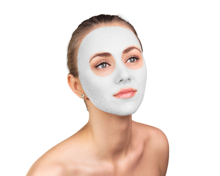 Photo pour Young woman with clay face mask on her face - image libre de droit