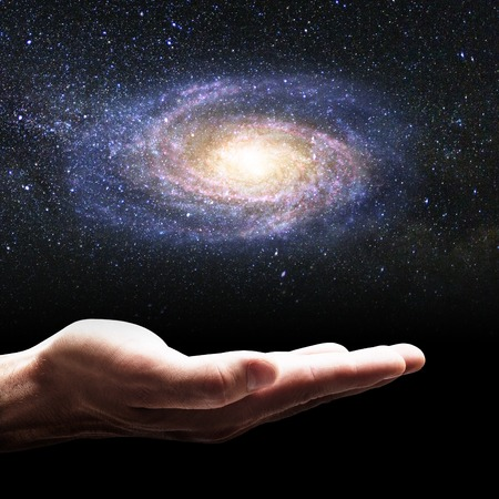 Photo for Businessman hand holding little galaxy. - Royalty Free Image