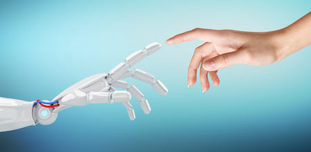 Photo pour Human hand touching an android hand. - image libre de droit