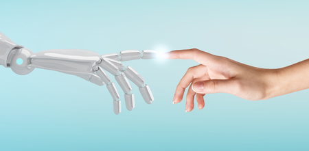 Photo pour Human hand touching an android hand. - image libre de droit