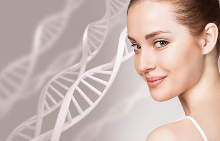 Foto de Portrait of sensual woman among DNA chains - Imagen libre de derechos