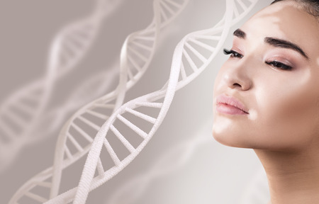 Foto de Young sensual woman with vitiligo in DNA chains. - Imagen libre de derechos