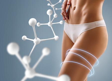 Photo pour Woman with perfect body near big molecule chain. - image libre de droit