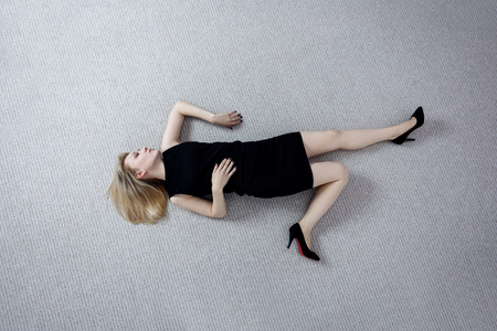Photo for Beautiful dead woman in black dress lying on the floor. - Royalty Free Image