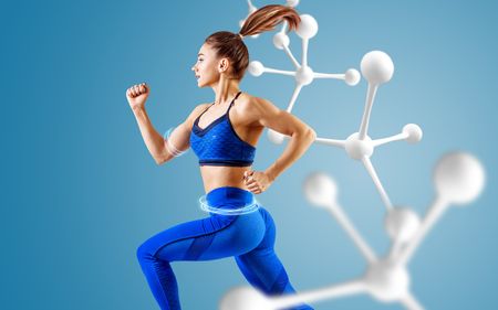 Foto per Sporty young woman runing and jumping near molecules. - Immagine Royalty Free
