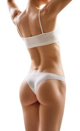 Foto de Muscular young woman athlete over white background. Perfect body concept. - Imagen libre de derechos