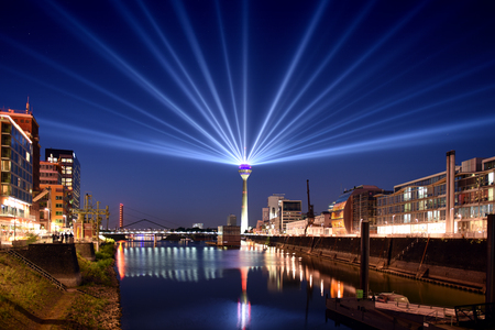 Photo pour Panoramic skyline view of Dusseldorf, Germany at night with illuminated rhine tower in media harbor district - image libre de droit