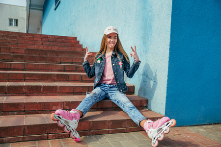 Photo for Little pretty girl on roller skates in city - Royalty Free Image