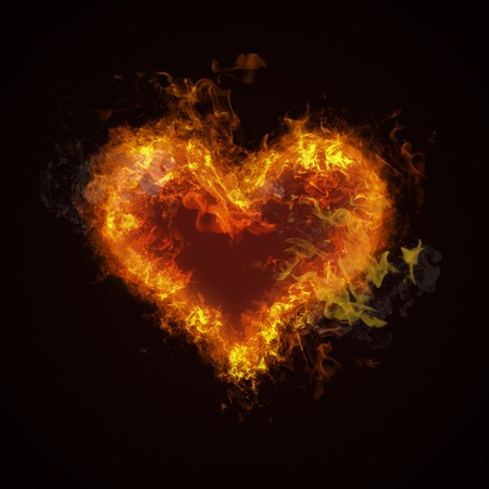 Foto de Hot fire heart burning on black background. Passion and desire - Imagen libre de derechos