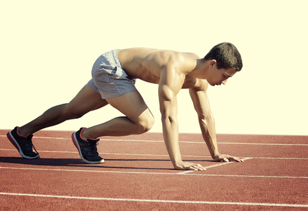 Photo pour Sport concept. Runner on the start line. Isolated on white - image libre de droit