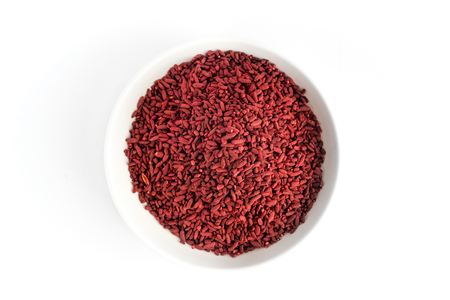 Photo for Red yeast fermented rice on white plate - Royalty Free Image