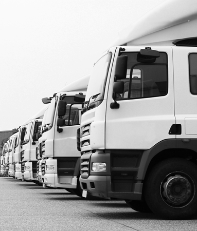 Foto per lorries parked up outside a company's car parking area - Immagine Royalty Free