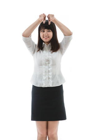 Portrait of a confident young woman with showing or introducing