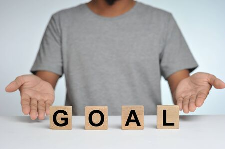 Photo for Business success for goal concept. Wooded cube block on a person standing as a background with word goal. Business goal. - Royalty Free Image