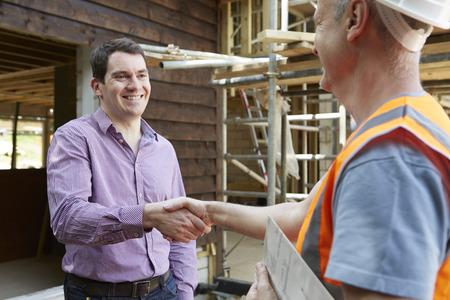 Photo pour Customer Shaking Hands With Builder - image libre de droit