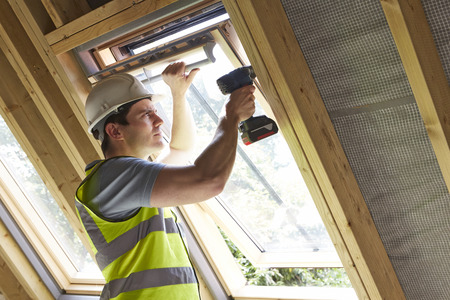 Photo for Construction Worker Using Drill To Install Window - Royalty Free Image