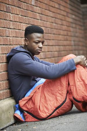 Foto de Vulnerable Teenage Boy Sleeping On The Street - Imagen libre de derechos