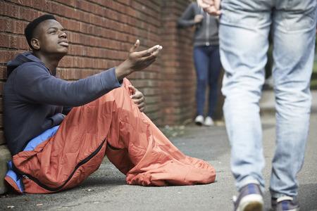 Foto de Homeless Teenage Boy Begging For Money On The Street - Imagen libre de derechos