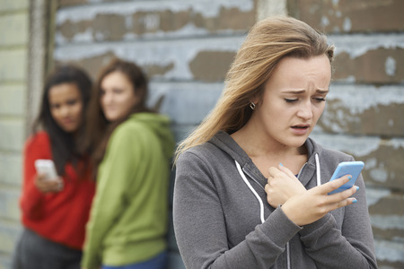 Photo for Teenage Girl Being Bullied By Text Message - Royalty Free Image