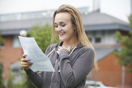Foto de Teenage Girl Happy With Good Exam Results - Imagen libre de derechos