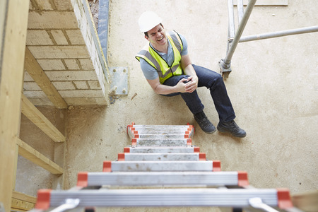 Photo pour Construction Worker Falling Off Ladder And Injuring Leg - image libre de droit