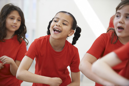 Foto de Group Of Children Enjoying Dance Class Together - Imagen libre de derechos