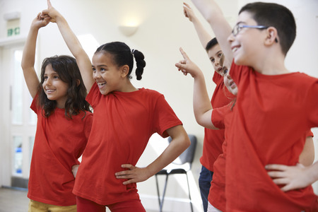 Foto de Group Of Children Enjoying Drama Class Together - Imagen libre de derechos