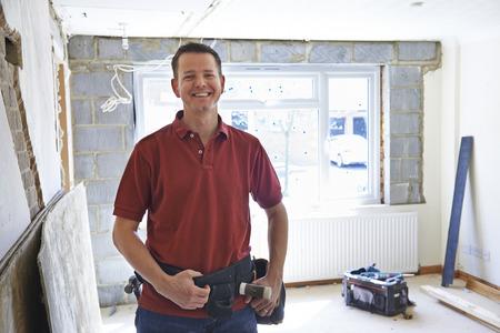 Photo pour Portrait Of Builder Carrying Out Home Improvements - image libre de droit