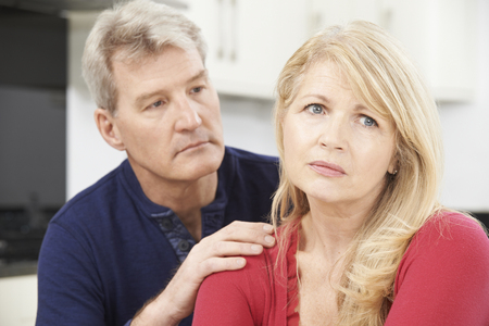 Foto de Mature Man Comforting Woman With Depression - Imagen libre de derechos