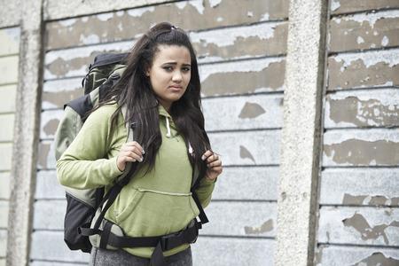 Foto de Portrait Of Homeless Teenage Girl On Street With Rucksack - Imagen libre de derechos