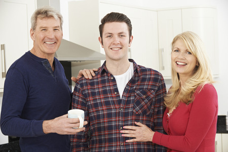 Photo for Portrait Of Family With Adult Son At Home - Royalty Free Image