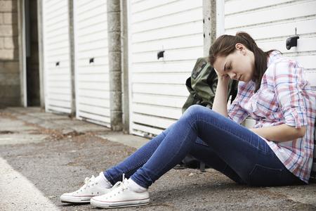 Foto de Homeless Teenage Girl On Streets With Rucksack - Imagen libre de derechos