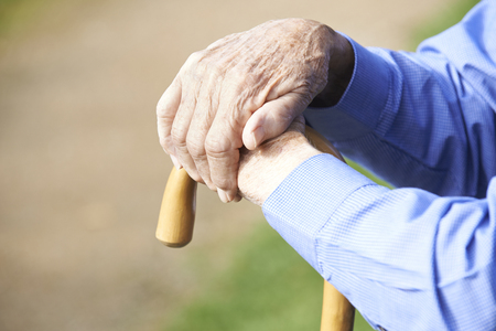 Photo for Close Up Of Senior Man's Hands Resting On Walking Stick - Royalty Free Image