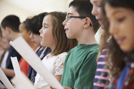 Photo for Group Of School Children Singing In Choir Together - Royalty Free Image
