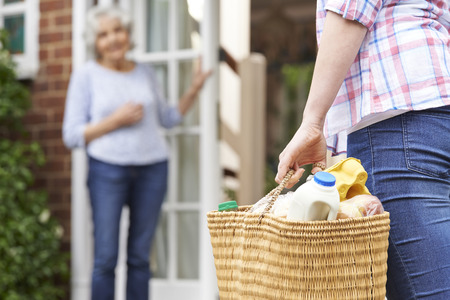 Foto de Person Doing Shopping For Elderly Neighbour - Imagen libre de derechos