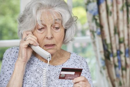 Photo pour Senior Woman Giving Credit Card Details On The Phone - image libre de droit