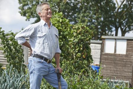 Photo pour Senior Man Suffering From Back Pain Whilst Gardening - image libre de droit
