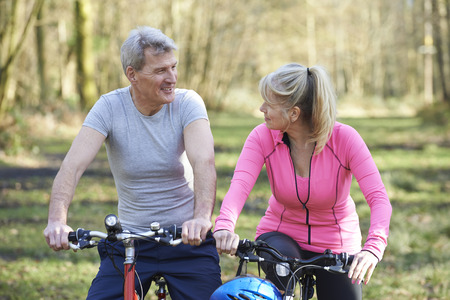 Photo pour Mature Couple On Cycle Ride In Countryside Together - image libre de droit