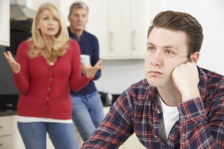 Photo pour Mature Parents Frustrated With Adult Son Living At Home - image libre de droit