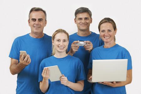 Foto de Studio Portrait Of IT Support Staff Wearing Uniform Against White Background - Imagen libre de derechos