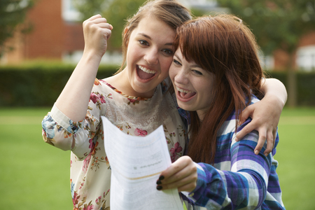 Photo pour Teenage Girls Celebrating Good Exam Result - image libre de droit