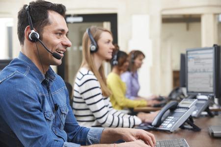 Photo pour Male Customer Services Agent In Call Centre - image libre de droit