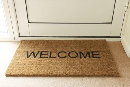 Foto de Welcome Mat Inside Doorway Of Home - Imagen libre de derechos