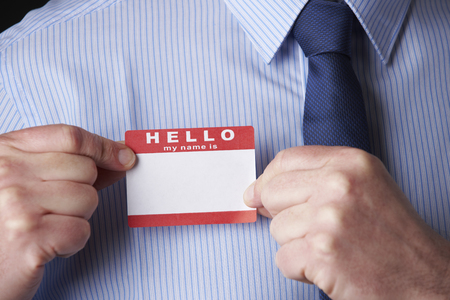 Photo for Businessman Attaching Name Tag At Conference - Royalty Free Image