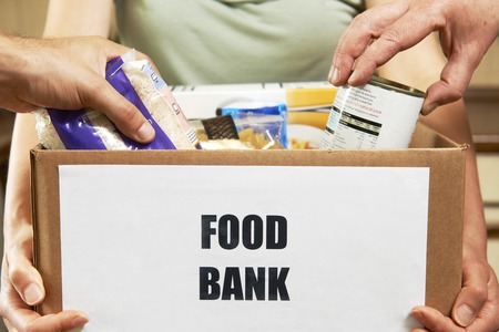 Foto de Making Donations To Food Bank - Imagen libre de derechos