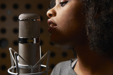 Photo for Female Vocalist In Recording Studio - Royalty Free Image