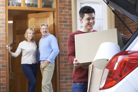 Photo for Adult Son Moving Out Of Parent's Home - Royalty Free Image