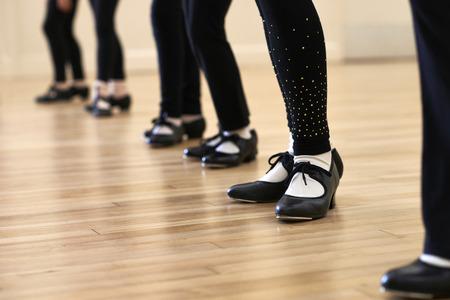 Foto de Close Up Of Feet In Children's Tap Dancing Class - Imagen libre de derechos