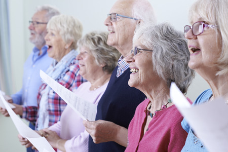 Photo for Group Of Seniors Singing In Choir Together - Royalty Free Image
