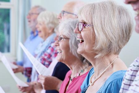 Photo pour Group Of Seniors Singing In Choir Together - image libre de droit